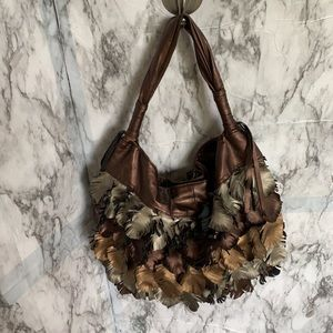 Bueno leather purse. Metallic copper/silver/gold